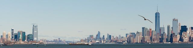 Lower Manhattan and Jersey City Skylines. NEW YORK, NEW YORK - March 29, 2017: The Lower Manhattan and Jersey City Skylines are seen from the Hudson River.  The Stock Photography