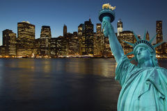 Lower Manhattan at night with Statue of LIberty Royalty Free Stock Photography