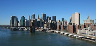 Lower Manhattan panoramic. Lower Manhattan and Brooklyn Bridge panoramic- aerial view Royalty Free Stock Photo