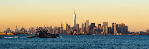 Lower Manhattan Panoramic Sunset from New York City Harbor. Panoramic Sunset of Lower Manhattan and New York City Harbor with Financial District skyscrapers and Royalty Free Stock Image