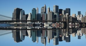 Lower Manhattan and reflection. Under a clear blue sky Stock Photo