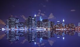 Lower Manhattan and reflection. At night Royalty Free Stock Image