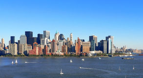 Lower Manhattan Sailing. Many boats dot the Hudson River around the Lower Manhattan skyline Stock Photos