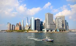 Lower Manhattan skyline on a Clear Blue day, Police Boat in foreground. New York City. New York Stock Image