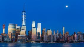 Lower Manhattan Skyline at blue hour, NYC. Lower Manhattan Skyline and moon rising at blue hour, NYC, USA Stock Photo