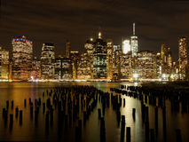Lower Manhattan Skyline at Night from Brooklyn Park. The bright lights of Manhattan over the East River Royalty Free Stock Photo