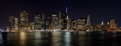 Lower Manhattan Skyline Panorama at Night. The Lower Manhattan Skyline and many of its landmark skyscrapers and buildings is the subject of this panoramic image Stock Photography