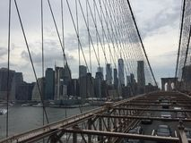LOWER MANHATTAN SKYLINE SEEN FROM THE BROOKLYN BRIDGE royalty free stock photos