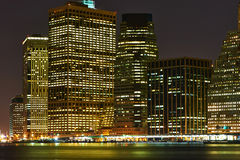 Lower Manhattan skyline view at night from Brooklyn Stock Image