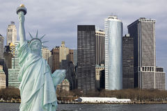 Lower Manhattan with statue of liberty stock images