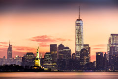 Lower Manhattan and the Statue of Liberty at sunrise Stock Photo