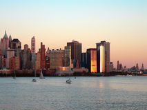 Lower Manhattan at Sundown. Lower Manhattan skyline at sunset as seen from across the Hudson River in Jersey City, New Jersey, Summer 2005 Royalty Free Stock Image