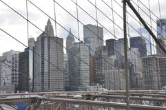Lower Manhattan panorama from Brooklyn Bridge over East River from New York City in United States royalty free stock photography