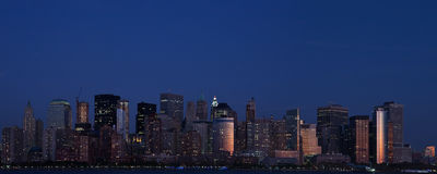Lower Manhattan At Twilight. Showing the lights and reflected sunset Stock Photos