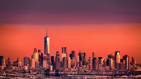 Lower Manhattan under an orange sunset Royalty Free Stock Photo