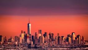 Lower Manhattan under an orange sunset Royalty Free Stock Photo