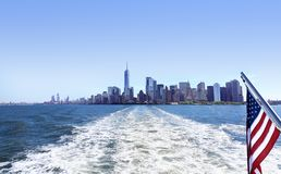 Lower Manhattan view from cruise ship or yacht with the flag of the United States of America in New York. Scenic view to NYC. Lower Manhattan view from cruise stock photo