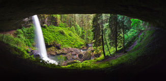Lower North Falls Pan. Lower North Falls in Silverton Springs State Park, Oregon allows hikers to travel behind the falls and gain a unique perspective Stock Photo