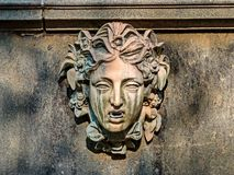 Mascaron-a kind of sculptural decoration of the building in the form of a human or animal head full face. Lower Park-part of the Palace and Park ensemble ` royalty free stock image