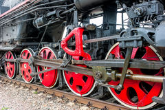 Lower part of the locomotive on the railroad Royalty Free Stock Photography