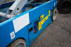 Lower part of scissor lift. Various buttons for operating machine. stock photography