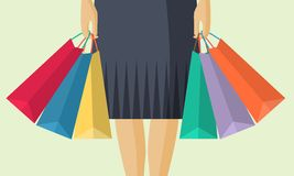 The lower part of the woman with packages after shopping in flat. The lower part of the woman with packages after shopping, flat design Stock Image