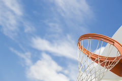 Lower Point of View of Community Basketball Hoop and Net. Abstract of Community Basketball Hoop and Net Against Blue Sky Stock Images