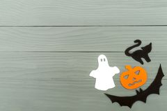 Lower right corner frame of halloween paper silhouettes. Lower right corner frame of halloween with pumpkin, ghost, bat and cat paper silhouettes on a gray Royalty Free Stock Photography