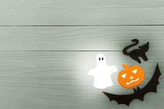 Lower right corner frame of halloween paper silhouettes. Lower right corner frame of halloween with pumpkin, ghost, bat and cat paper silhouettes on a gray Royalty Free Stock Photos