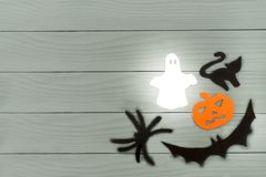 Lower right corner frame of halloween paper silhouettes. Lower right corner frame of halloween with pumpkin, ghost, bat, spider and cat paper silhouettes on a Royalty Free Stock Images