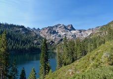 Lower Sardine Lake, Sierra Buttes. Lower Sardine Lake rests below the Sierra Buttes in the Sierra Nevada Mountains of Northern California stock images
