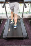 Lower section of fit man running on treadmill Royalty Free Stock Photo