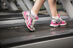 Lower section of a woman on a treadmill Stock Photos
