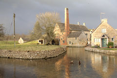 Lower Slaughter Mill and Stream. Lower Slaughter Mill, Cotswolds, UK. Winner of the prettiest Cotswold village competition. Now a museum Stock Image