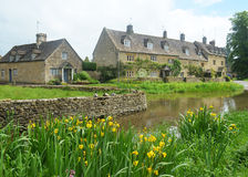 Lower Slaughter Village. Scenic view of old houses in Lower Slaughter Village with a river in the foreground, Cotswolds, England Royalty Free Stock Images