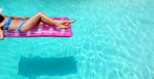 Free Lower Torso Or Woman In Bikini Lounging In Pool Stock Image - 158610781