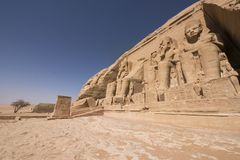 Panoramic view of Great Temple of Ramses II in Abu Simbel, Egypt. Lower wide angle view of the façade of Great Temple of Ramses II in Abu Simbel, UNESCO royalty free stock photos