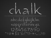 Lowercase letters, numbers and symbols hand drawn on chalkboard. Lowercase letters numbers and symbols hand drawn on a chalkboard. Eps8. RGB. Global colors Royalty Free Stock Image