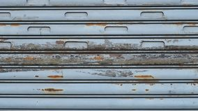 Bluish rusty roller shutters with chipped paint. Lowered bluish rusty shutters with chipped paint Stock Image