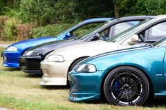 Lowered vehicles lined up Stock Photo