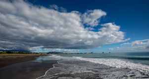 Lowering Cloud. At New Plymouth beach. The cloud is lowering to the sea Stock Photo