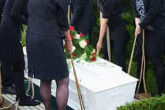 Lowering coffin Stock Images