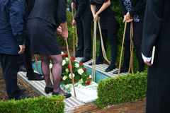Lowering coffin Stock Photography