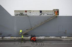 Lowering the gangway Stock Photo