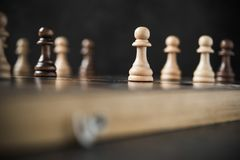 The lowest chess piece in game rank pawn. Tactics and Leadership concept stock image