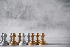 The lowest chess piece in game rank pawn. Tactics and Leadership concept royalty free stock photo