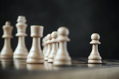 The lowest chess piece in game rank pawn. Tactics and Leadership concept. selective focus stock photo