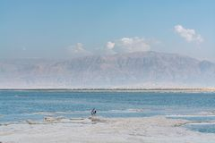Lowest salty lake in world below sea level Dead sea, full of min royalty free stock images