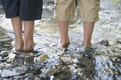 Lowsection Of Boys In Shallow Water Stock Photos