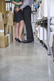 Lowsection Of Couple Embracing In Office Store Room Royalty Free Stock Photo